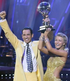 Helio Castroneves celebrates his win with Juliette