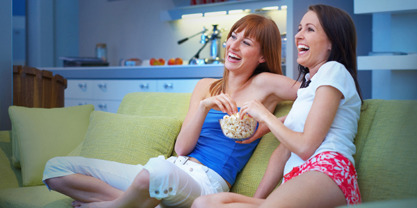 women enjoying chick flicks