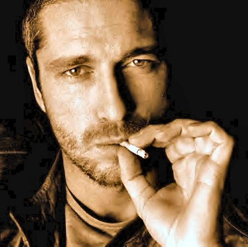 Actor Gerard Butler smoking.
