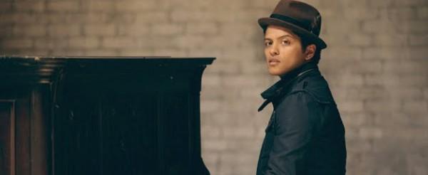 Bruno Mars playing piano.