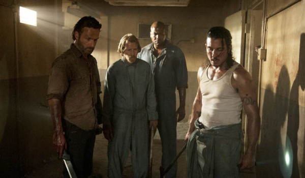 Rick Grimes and prison inmates on the AMC series, The Walking Dead.