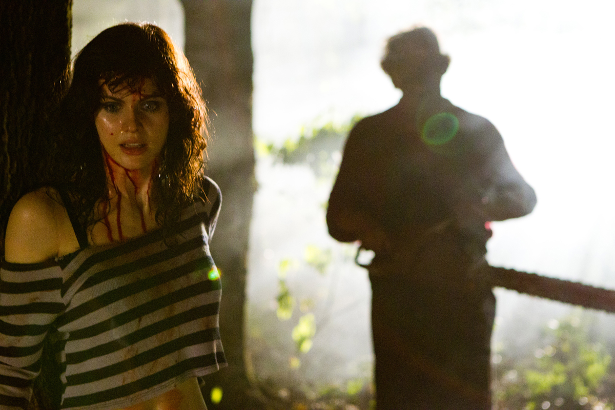 Alexandra Daddario and Leatherface in Texas Chainsaw 3D.