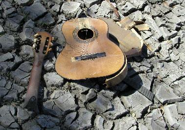 A broken guitar.