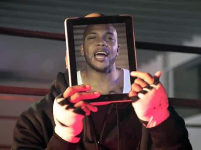 "Flo Rida holding an iPad in the ""Good Feeling"" video."