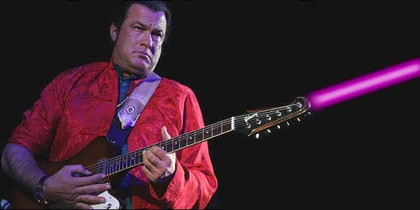 Steven Seagal shooting a laser out of his guitar.