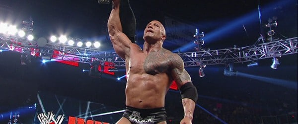 The Rock holding the WWE Championship at the Royal Rumble. 