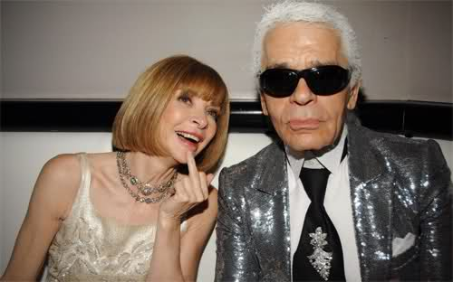 Anna wintour gives the middle finger next to karl lagerfeld