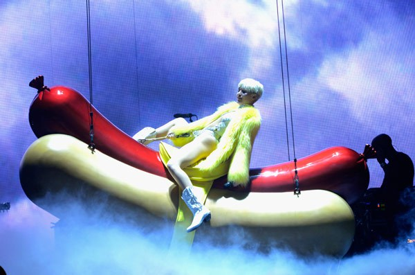 Miley Cyrus Rides A Hot Dog