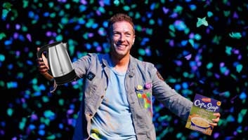 chris martin holding a cup a soup