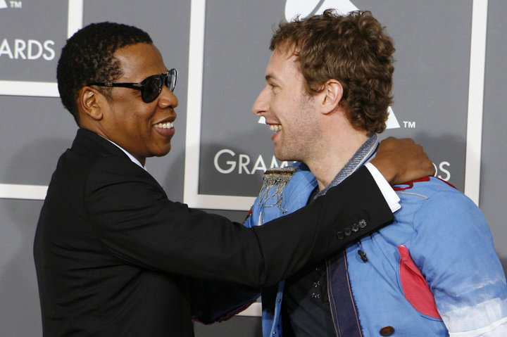 Jay z greets coldplay's chris martin as they arrive at the 51st annual grammy awards in los angeles